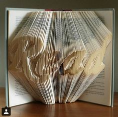 Folded Book Art - Gifts for Book Lovers - READ - Altered Book - Origami - Unique Present - Teacher's Gift. Heck with the teachers! I wanna put this in my library!