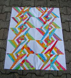 [ Eastern  Sunrise ] The work of a talented seamstress who has available @ her blog, Happy Turtle Quilts, the paper piecing pattern; it's free & for personal use only.