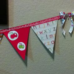 Back to school bunting banner! Hot glue gun, various scrapbooking papers and ribbon. Super quick, easy and adorable!!!