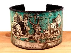 Leather Cuff Alice in Wonderland, Tea Party ( Etsy )