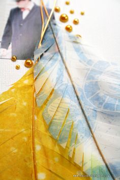 Create your own feathers with deli paper or vellum stamped with Staz-On and backed with a wire