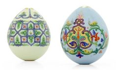 Two Porcelain Easter Eggs By the Imperial Porcelain Factory, St Petersburg, circa 1890. Each ovoid, the front of one painted with stylised scrolling foliage entwining a deep purple strapwork framed cartouche with gilt ciselé interior, the reverse with similar motif in the shape of a lozenge on blue ground, the other painted with blue tracery frieze centred by a gilt ciselé cross and enclosing pink flowerheads with stylised leaves, both unmarked.
