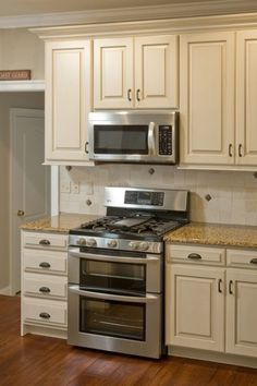 Traditional Kitchen with Full tile backsplash, Complex granite counters, Ms international amber yellow granite, One-wall