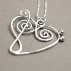 music heart NECKLACE. treble clef meets bass clef. music jewelry in sterling silver.
