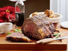 Get this all-star, easy-to-follow Brined Roast Rack of Pork with Apple Chutney and Sour Mash Sauce recipe from Bobby Flay