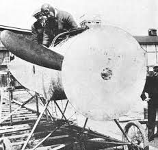 Anthony Fokker inspecting the synchronization job between the propeller and the Parabellum machine guns in a E III