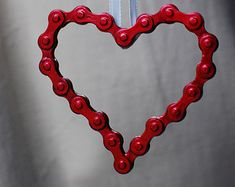 50% of all sales go to support the hosting fees for Eastern European orphans through New Horizons for Children.  This heart-shaped keychain is made of re-purposed used bike chain. All chains are completely cleaned and de-greased prior to being locked into a shape. This chain is polished and left in its natural steel color with a light lacquer finish, but Im happy to paint it if you have a favorite color. Shaped and immobilized chain is attached to a key ring (split ring).