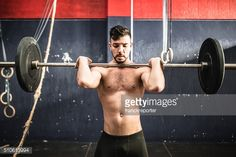 Stock Photo : strong man weightlifting a barbell