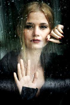 Window and rain. emotive. Portrait Photography