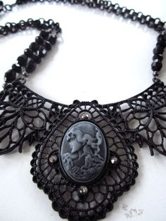 Check out this item in my Etsy shop https://www.etsy.com/listing/254271343/black-bib-necklace-cameo-necklace-black