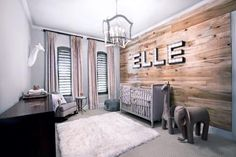 This modern and rustic nursery is the perfect antidote to the overly girly space. A subtle animal theme blends with organic details like the pine accent wall for a charming room that will grow right along with the child.