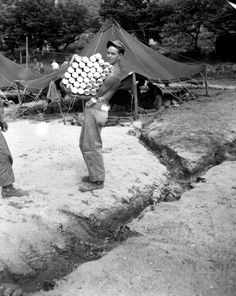 Carrying a full load of beer donated by the Marine Corps League for Marines in Korea, is Cpl. Quisenberry of Dayton, Ohio on July Usmc, Marines, Once A Marine, Korean War, American Soldiers, Military History, Military Photos, Vietnam War, Cold War
