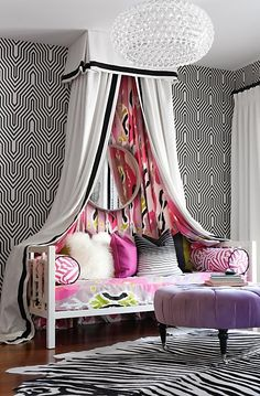 FUN! Canopy daybed. Patterned wallpaper, mix and match pillows, light fixture.