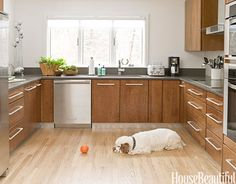 By keeping the U-shape layout but updating the appliances and cabinets, Pine Cone Hill's Annie Selke remodeled her ranch house kitchen without spending too much time or money. She also kept durability in mind when selecting building materials, like the stainless-steel kickplates under the cabinets that help prevent scuff marks. Plus: Conquer Your Fear of Color   - HouseBeautiful.com