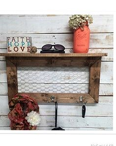 Entry Way Shelf, entryway shelf, coat rack, galvanized metal, wood shelf, metal shelf, Rustic Shelf, entry way shelves, coat rack with shelf. Collect your keys, coats, mail and more with this stylish rustic shelf. This metal chicken wire and wood shelf is a simple way to add an rustic farmhouse touch to your decor. The bottom of this rustic shelf is bordered with three metal hooks, enhancing its function. Made of solid pine for good quality and long life with a distressed rustic look…
