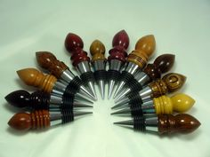 'Flame' style wine stoppers made from a variety of woods