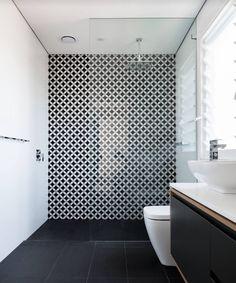Tile accent wall, frameless glass
