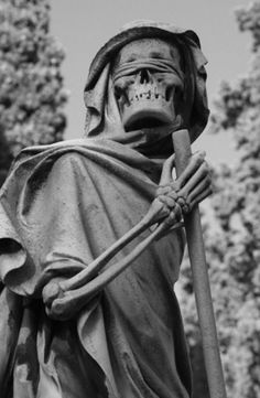 The grim reaper statue located at the English Cemetery in Florence, Italy.
