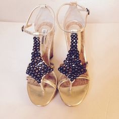 "Steve Madden Sandals Beautiful gold and cork wedge sandals.  Olive colored embellishment.  Adjustable ankle strap.  4 1/2"" wedge heel.  Perfect resort wear shoe.  Vacation anyone?  Minor wear, in good condition.  No trades.  Bundle and save Steve Madden Shoes Sandals"