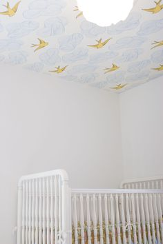 Whimsical wallpaper on the ceiling.