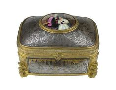 19th Century Niello Box with Hand Painted Porcelain Plaque and Figural Bronze Mounts. Gold Washed Interior Signed on bottom with 3 Clovers, A, 4 and SN. Wear and Rubbing or in Otherwise Good Condition. Measures 4-1/4 Tall, 5-3/4 Inches Wide, 3-3/4 Inches Depth. Shipping $54.00