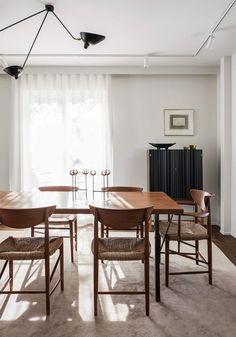 Black and brown kitchen. #Mid-century #DiningRoom #Drapes #ModernLightingFixture