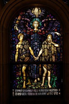 In this stained glass image, an angel of the Lord banishes Adam and Eve from the garden of Eden. The window is at the Holy Hill church in Hubertus, WI. (Catholic Herald photo by Sam Lucero)