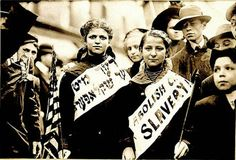 """These women, marching on May 1, 1909 in New York, wear signs reading """"Abolish Child Slavery"""" in English and Yiddish. Jewish workers in the US began forming unions [pdf] in the 1880s, and the Jewish labor movement experienced a turning point in the 1930s as Jewish workers turned away from Communism and began to respond to growing anti-Semitism worldwide."""