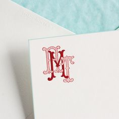 Bone White Card with Azure Bevel and Custom Monogram in Cranberry, Envelope Lined with Corresponding Tissue.
