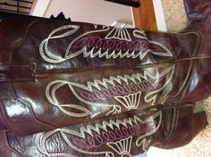 Pink painted cowgirl boots. Bought used cowboy boots that needed some color and painted the inside stitching magenta. Love them now.