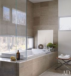 I could spend hours in this soaking tub. Loving the window placement and the way the tub deck becomes a bench in the shower.
