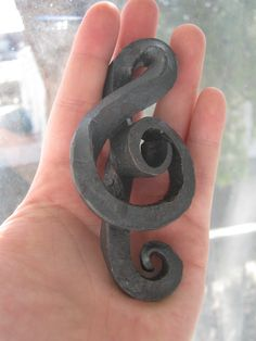 Treble clef made in blacksmithing. The bottom loop is backwards, because I didn't have reference.