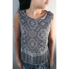 Mosaic Open Back Tank Top 🌻 This is our refashioned Mosaic print open back fringe tank top. The color of the print is black and white. Bust is 18 inches & length is 22 inches, with fringe it is 24 inches. It is 100% polyester and the lining is 100% rayon. It goes great with cutoff shorts for a bohemian summer look or pairs great with a pencil skirt for a more classic look. This is a gorgeous peace to add to your closet!🌻✌🏼️ Dress Barn Tops Tank Tops