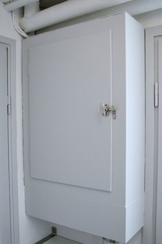she made a cabinet to hide her fuse box but i really like the fuse box door · bathroom ideascabinets