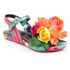 Can a rose ever smell so sweet? These funky, fresh sandals will brighten up your day what ever the weather! Comes with a floral posey on the toe, floral and polka dot fabric upper and a buckle fastening ankle strap.