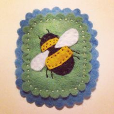 Hand embroidered felt bee brooch with lovely scallop edge detail. Presented on a Lexys Utopia card.  *please note that each brooch is made to order