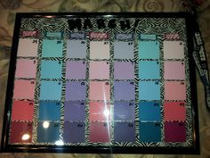 My diy dry erase calander i made! A frame, paint swatches, zebra duct tape & a dry erase marker! Write on glass & erase every month :)