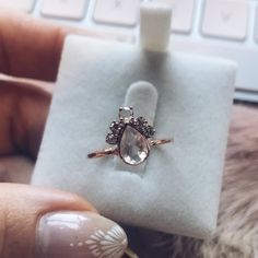 A stunning statement ring, this solid 14K rose gold ring features a moonstone teardrop and is adorned by enough sparkling diamond stones to take your breath away. The perfect engagement ring or everyday investment piece.Solid 14K rose goldNatural moonstone (center stone)Natural white diamonds .04...