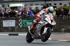 Hickman lifts a wheel at St Ninian's in yesterday's Superstock TT