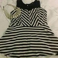 Tank Cream and black peplum tank. Black mesh on top and part of back. Super cute. Only worn a couple times. Euc. Monteau Tops Tank Tops