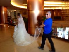@Cesar Millan: She didn't know it was me carrying her dress! #weddingdayphotobomb #photobomb ✌️ laugh out loud lucky her