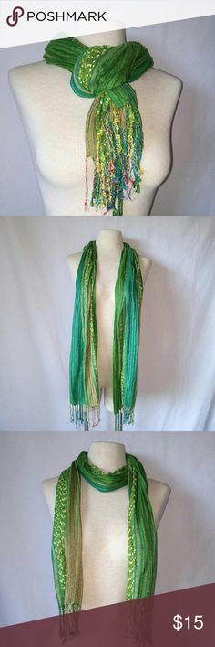 Collectioneighteen Woven Scarf #hundredsofscarves Beautiful Green & Blue Striped Scarf with Multi-Colored Fringe and Metallic Accents by collectioneighteen. In excellent used condition. From a smoke free home.  OFFERS WELCOME.  BUNDLE: 20% Off on 2+ Items. DAILY SHIPPING. POSH AMBASSADOR.  #hundredsofscarves @gratefulbox collectioneighteen Accessories Scarves & Wraps