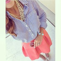 Pearl necklaces, blue and white striped button-up shirt, a coral skirt, and nude heels.