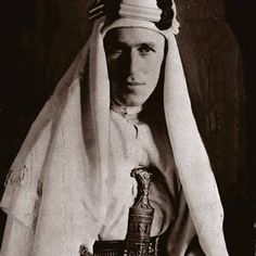 A 1930 portrait of Lawrence of Arabia, five years before his death in a motorbike accident. During the war Lawrence had been advised by Arab leaders to don the traditional white robes of the desert and in so doing earned kudos among the troops