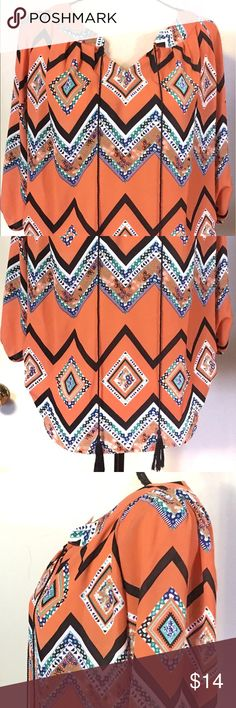 """MY MICHELLE Aztec Boho Long Sleeve Blouse Top S Description  • Brand - My Michelle • Size - Small • Color - Orange Blue and white • Material content - Polyester 100% • Dimensions - Armpit to armpit is 22"""" and Shoulder seam to bottom of hem 24.5"""" V-neck, long sleeve, Ruched sides and a string tie are features of this top.  Condition - EUC Shipping - Items will ship with tracking number uploaded within one business day of payment receipt. I try to describe all items accurately. Please view all…"""