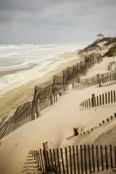 It's fun to see different beaches and how different they look. At this one, they have the fences up to hold more sand in...It could be a Massachusettes beach...?