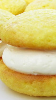Lemon Cream Whoopie Pies Recipe ~ The lightly sweet frosting is incredibly light and fluffy, perfect for sandwiching between sweet, lemony cake-cookies