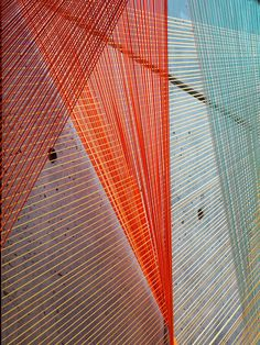 Arch Daily nés Esnal's Prism installation uses colorful elastic rope to form triangular spaces that filter light into the lobby of a new residential building in New York