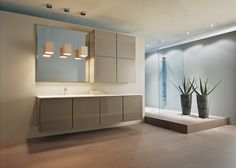 Customers can create their own composition and organize the internal space of the cabinets with internal fittings and accessories.  The simple and functional structure is made up of modules.  The fronts can be made with three different opening types (door, transom door or pull out drawers) and are available in lacquered finish (glossy or matt), wood finish, leather. The cabinets can contain internal drawers with make-up storage or with safety lock, as well as a wide range of equipment…