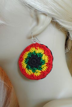 Rastafari Kaleidoscope Earrings. These Rastafari Circles were crocheted using crochet thread. A nice size not too loud, huge, or gaudy. These colors are growing ever popular. You'll get tons of compliments and goes beautifully with a nice, cute, yellow shirt.   Earrings measure 1½ inches in diameter  And of course the main ingredient is positive vibes